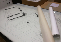 Ink-drawn large scale plans.
